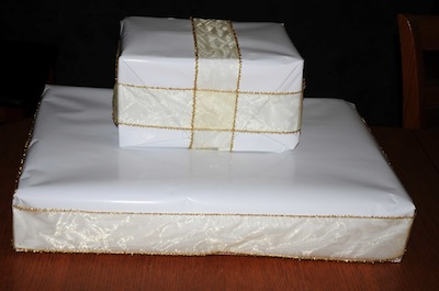 covered boxes with ribbon