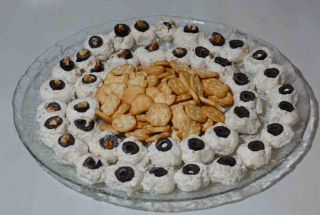 photo of cream cheese eyeballs for kids halloween recipes
