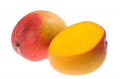 mango cut in half and whole