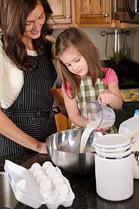mom and girl cooking