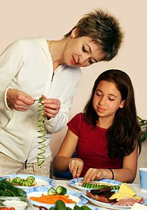 mom and girl preparing vegetables