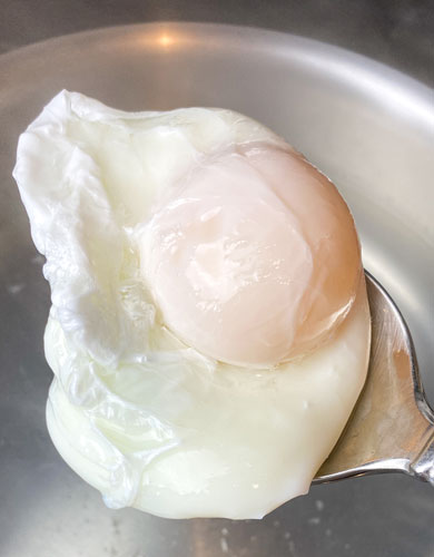 poached egg in boiling water