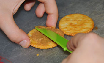 kids cooking lessons on spreading with a knife or spreader.