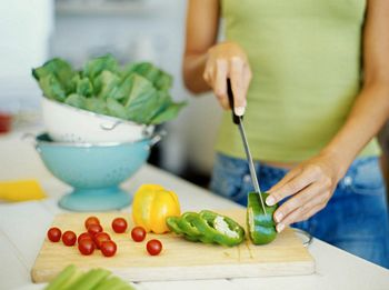 chopping vegetables in kitchen