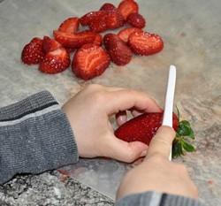 kids chopping strawberries