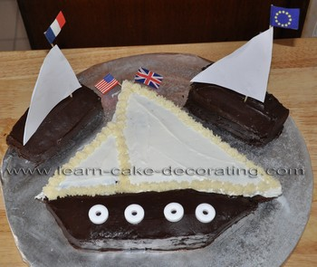 sailboat cake with smaller boats