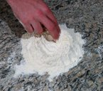 mixing homemade pasta dough by hand