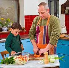 father with boy cooking