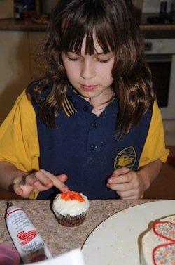 kids decorating cupcake
