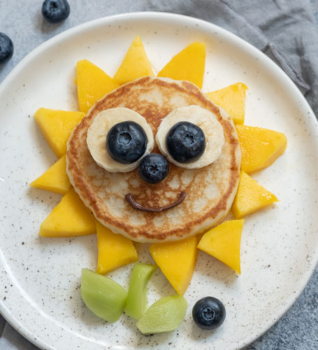 sunflower made fruit and pancakes