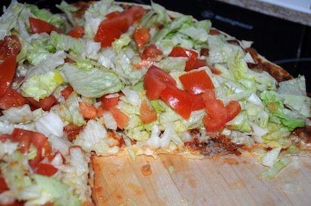 taco pizza sliced