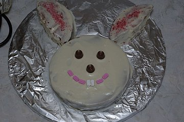 Make a bunny cake out of 2 round cake pans