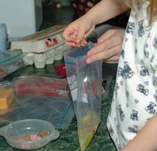 adding ingredients to a baggie omelet