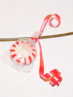 Tie candy onto wreath with ribbon
