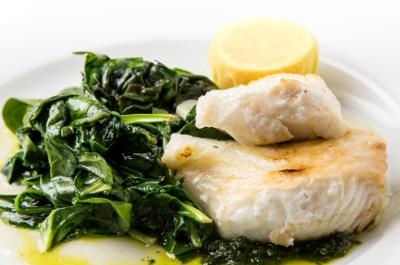 cooked spinach with fish dinner