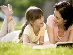 mom and girl reading
