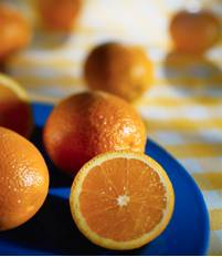 orange food facts picture of whole orange and orange cut in half